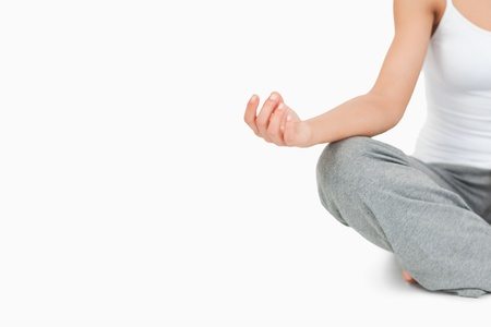 Fit woman in the Sukhasana position against a white background Stock Photo - 11623721