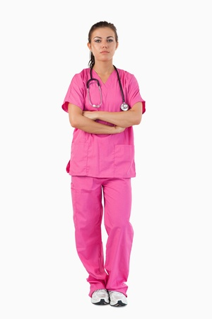 Portrait of a serious nurse against a white background photo