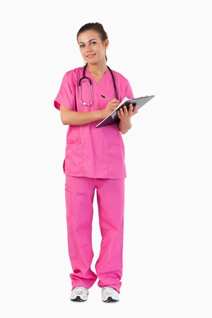 Portrait of a female doctor taking notes against a white background Stock Photo - 11624087