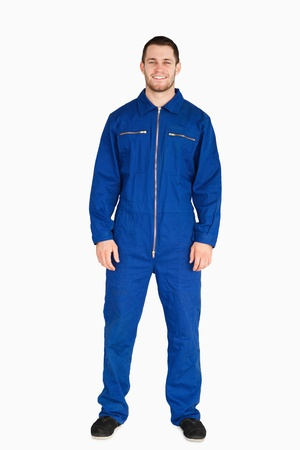 boiler suit: Young mechanic in boiler suit against a white background Stock Photo