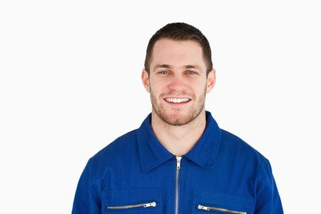 studio happy overall: Smiling young blue collar worker against a white background Stock Photo