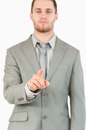 Finger of businessman pointing against a white background photo