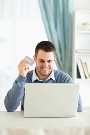 Young male happy about online shopping photo