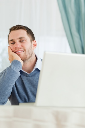 Young businessman in his homeoffice looking tired photo