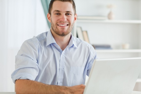 rolled up sleeves: Smiling young businessman with rolled up sleeves in his homebusiness
