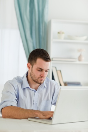 rolled up sleeves: Young businessman with rolled up sleeves working on his laptop Stock Photo