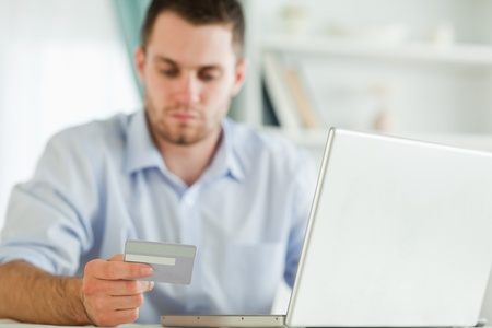 Young businessman with credit card and notebook photo