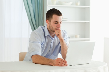 Young businessman working concentrated on his notebook photo