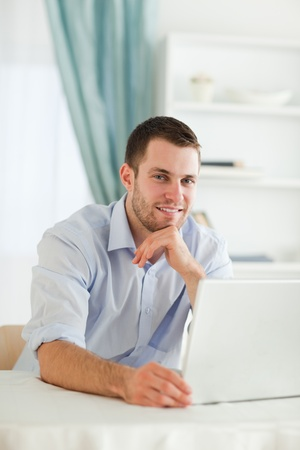Young businessman reading an e-mail on his notebook photo