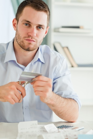 Young businessman has to get rid of his credit card photo