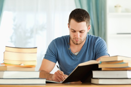 Male student doing his homework photo