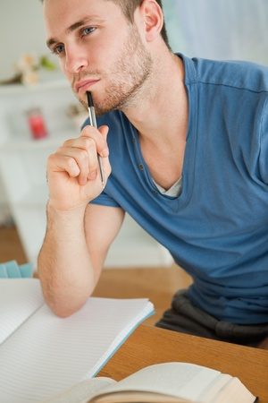 absorbed: Young male student doing his homework