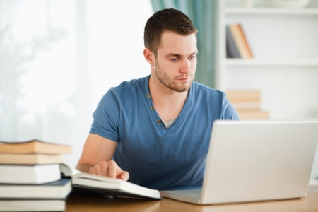 Male student researching material on the internet photo