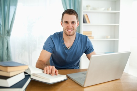 Smiling male student happy about his research results Stock Photo - 11635440