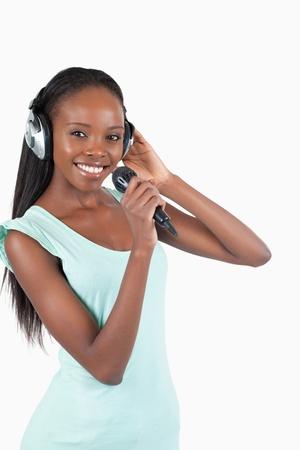 kareoke: Happy smiling woman singing against a white background Stock Photo