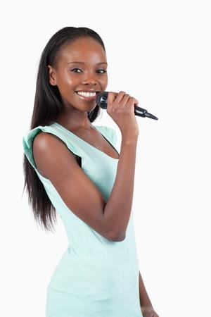 kareoke: Happy smiling female singer against a white background