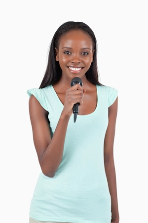 kareoke: Brightly smiling female singer against a white background