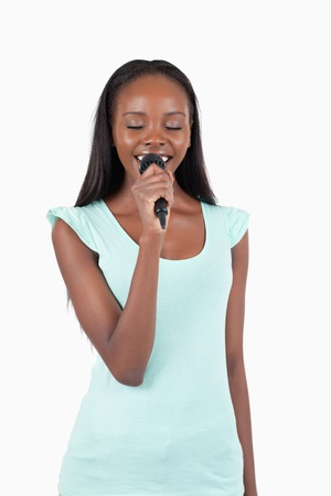 kareoke: Cheerful smiling female singer against a white background Stock Photo