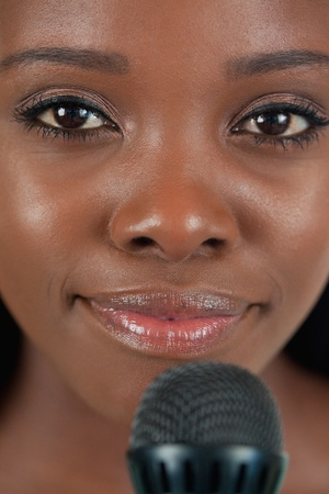 kareoke: Close up of smiling female singer with microphone