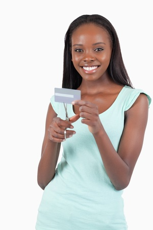 Happy smiling woman destroying her credit card against a white background Stock Photo - 11634781