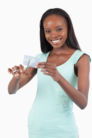 Smiling woman solving her financial problems against a white background photo