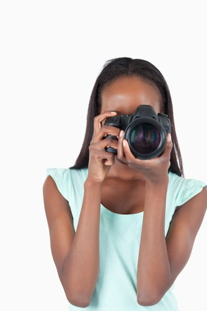 Young photographer at work against a white background photo