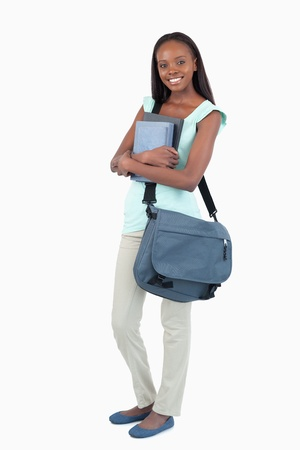 Female student about to attend class against a white background photo