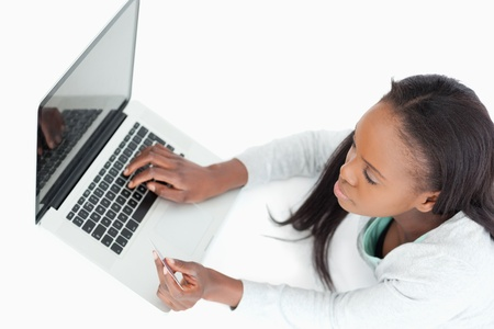 chat online: Woman booking a flight online against a white background