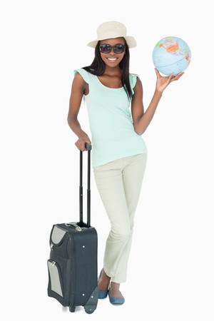 Young woman going on a world tour against a white background photo