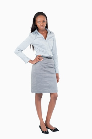 Portrait of a businesswoman posing against a white background photo