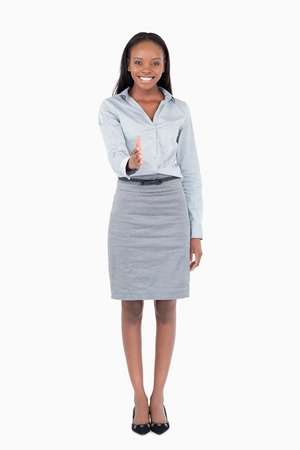Portrait of a businesswoman giving her hand against a white background photo