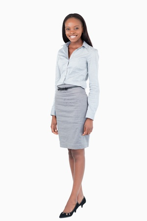Portrait of a businesswoman standing up against a white background photo