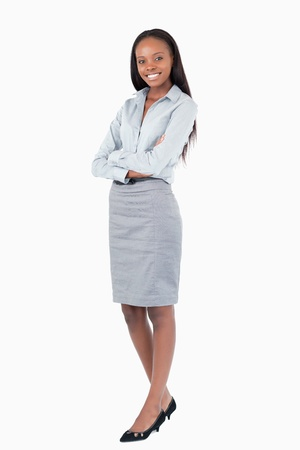 Portrait of a businesswoman with the arms crossed against a white background Stock Photo - 11623894