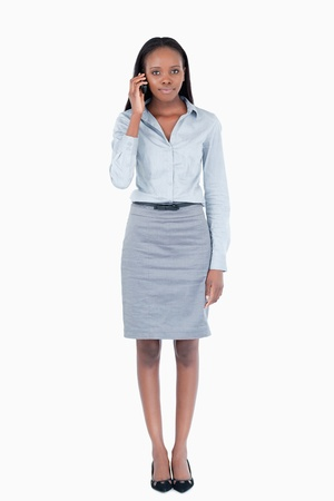Portrait of a cute businesswoman making a phone call against a white background photo