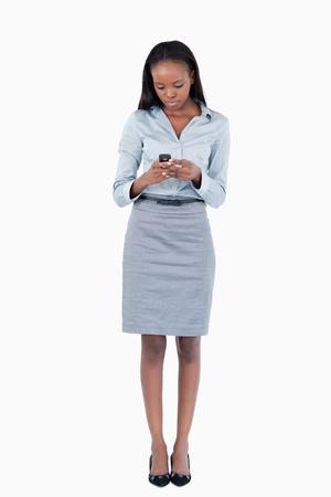 Portrait of a businesswoman sending a text message against a white background photo