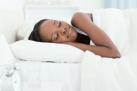 Serene woman sleeping against a white background photo