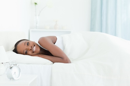 calm woman: Calm woman waking up in her bedroom