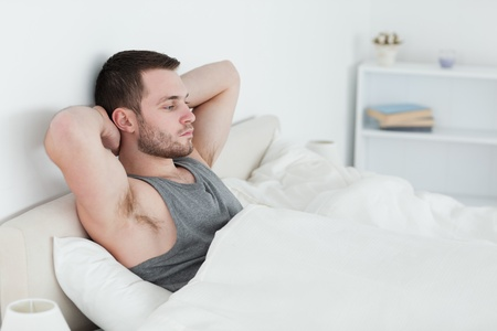Tired man waking up in his bedroom Stock Photo - 11635123