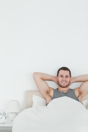 Portrait of a happy man waking up in his bedroom Stock Photo - 11636872