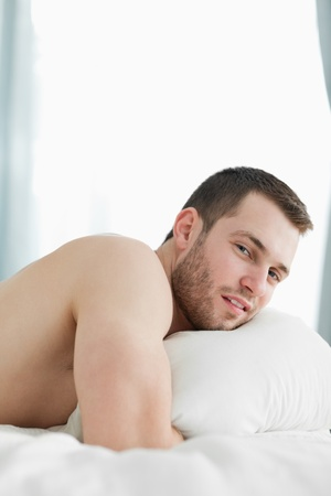 Portrait of a quiet man lying on his belly in his bedroom Stock Photo - 11637068