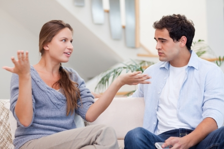 Angry couple having an argument in their living room photo