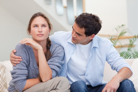 lovers quarrel: Woman being mad at her husband in their living room