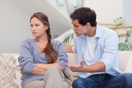 Seus woman being mad at her boyfriend in their living room Stock Photo - 11632798
