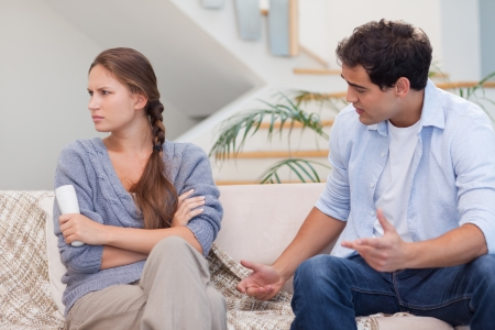 Man arguing with his wife in their living room Stock Photo - 11632821