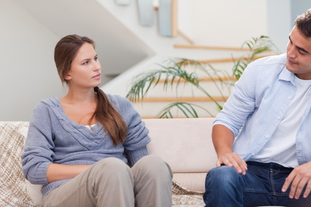 Couple talking seriously in their living room photo