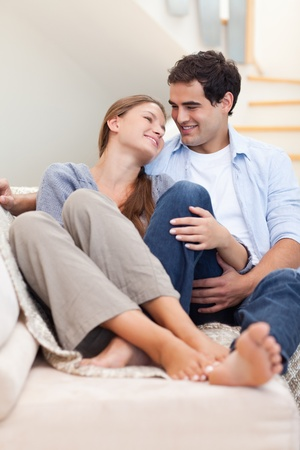Portrait of a couple lying on a couch while looking at each other Stock Photo - 11632496