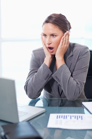Portrait of a chocked businesswoman working in her office Stock Photo - 11632372
