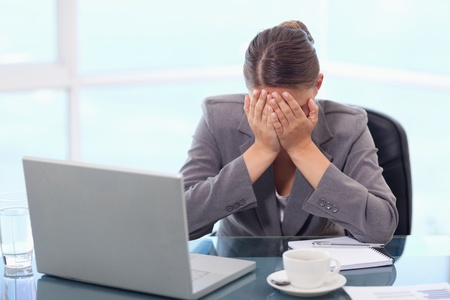 Frustrated businesswoman crying in her office photo