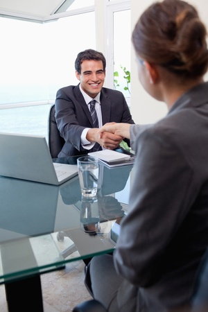 applicant: Portrait of a manager interviewing a female applicant in his office