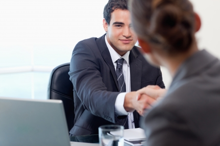 Manager interviewing a female applicant in his office photo